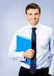 Business man with folder, on violet