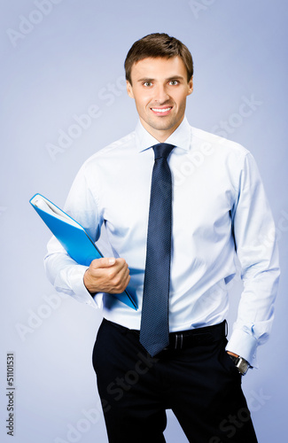 Business man with folder, on violet