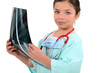 Young girl pretending to be a radiologist
