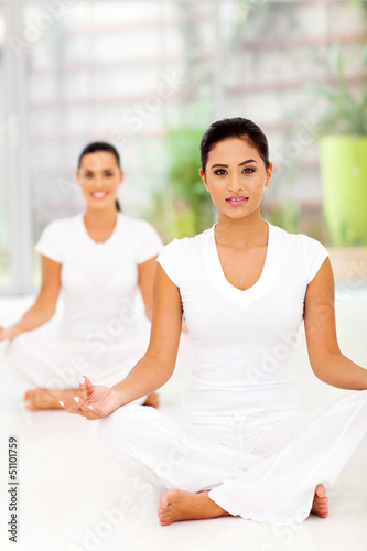 attractive young women meditating