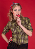Pin up girl in a green shirt with candy