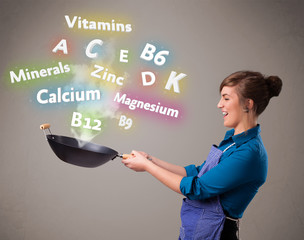 Young woman cooking vitamins and minerals