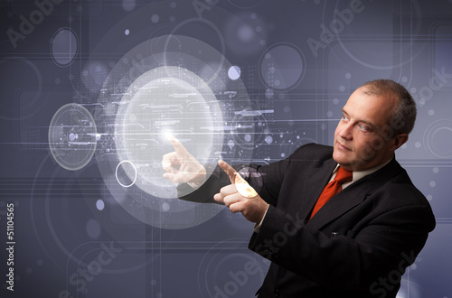 Businessman touching abstract high technology circular buttons