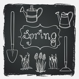 Set of hand drawn spring flowers and tools on chalkboard