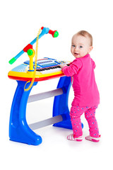 little girl and the keyboard on white background
