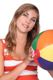 Teenage girl with beach ball