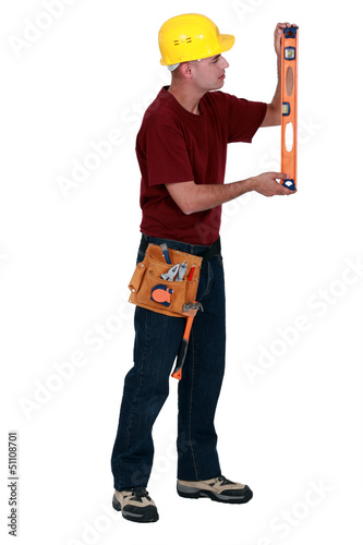 Worker checking a spirit level