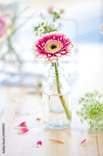 canvas print picture Fresh flowers in little glass bottles