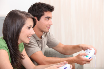 portrait of teenagers playing video game