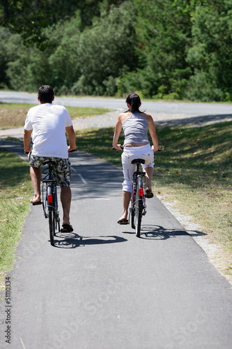 Man and woman having a bike ride