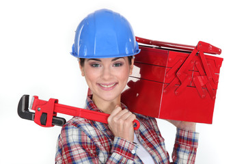 Happy woman carrying tools