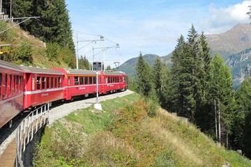 red train around the beautiful Swiss mountains 19