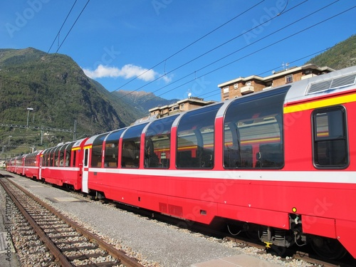red train around the beautiful Swiss mountains 1