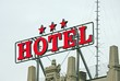 Huge written three star HOTEL above the roof of a building in th