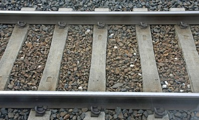 train track with sleepers and Rails where stones passing freight