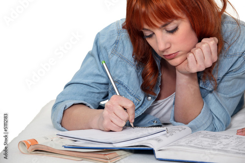 Young woman completing her homework