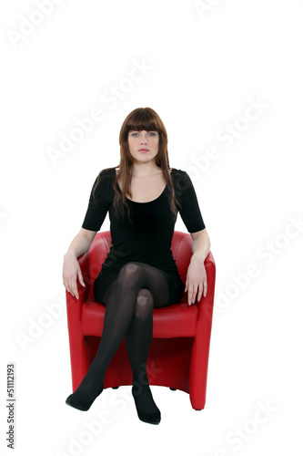 Woman sat on red leather chair