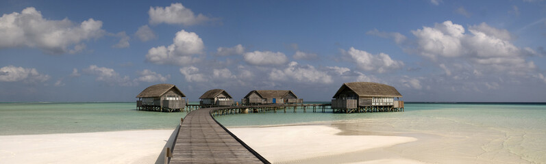 Wood villa in a maldivian lagoon