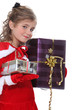 Girl dressed as Santa Claus with gifts