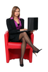 Businesswoman looking at her laptop