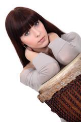 Brunette posing with bongo
