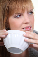 Woman enjoying a hot drink