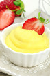 Delicious vanilla cream dessert with fresh strawberries