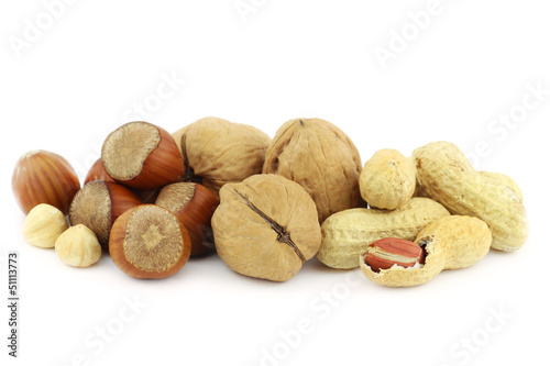 Mix of nuts - hazelnuts, walnuts and peanuts - on white