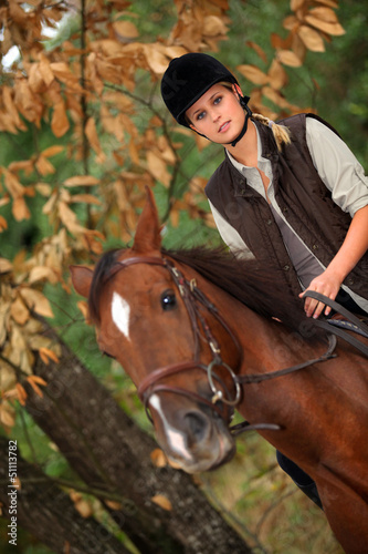 Blond woman riding horse