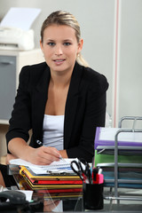 Blond receptionist sat at her desk