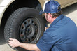 Auto Mechanic Removing Tire