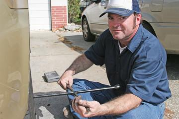 Mechanic Using Tire Iron