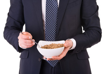Businessman having breakfast with cereal bowl.