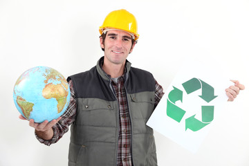 A manual worker promoting recycling.