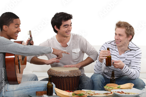Three male friends playing instruments
