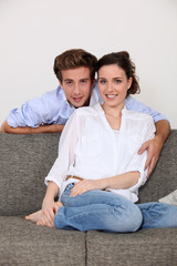 Young couple sat on sofa