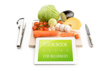 Concept of cookbook for beginners on the tablet computer