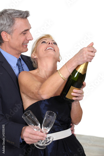 mature couple celebrating with champagne