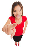 Woman pointing camera smiling happy