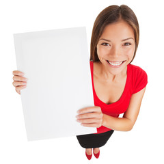 Sign woman holding up a blank white poster