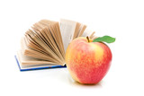 open book and an apple on a white background
