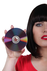 Young woman showing compact disc