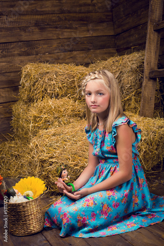 A cute girl in the hayloft