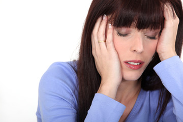 young woman having migraine