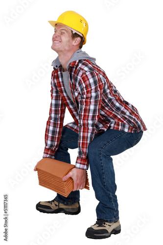 Tradesman lifting a heavy load