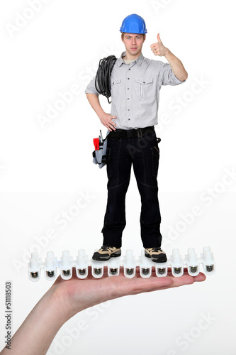 Handyman giving the thumbs-up whilst standing on giant hand