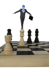 Architect balancing in chess piece