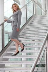 Businesswoman walking down steps