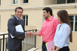 Couple shaking the hand of a real estate agent