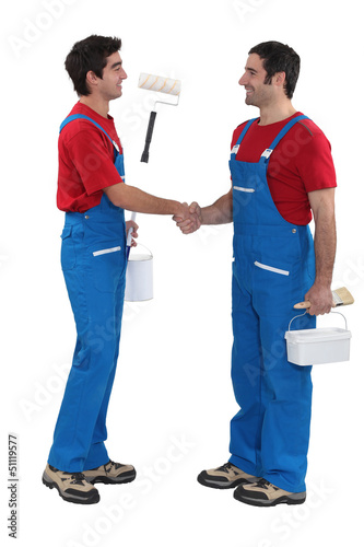 Housepainters handshaking